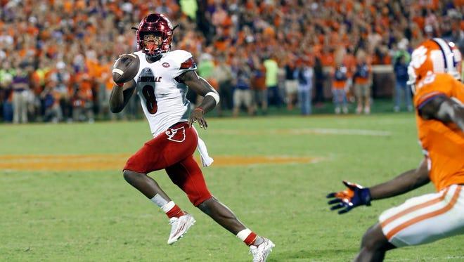 Louisville's Lamar Jackson looks to pass down the field.   Oct. 1, 2016