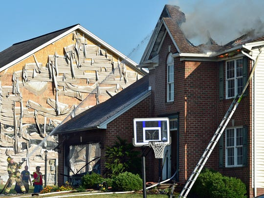 Firefighters attack hot spots at a house fire Tuesday,