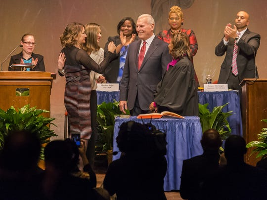 Wilmington Mayor Mike Purzycki turns to his family after taking the oath of office during inauguration ceremonies for Wilmington city government on Tuesday night.