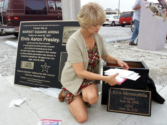 In this 2002 photo, Kay Lipps sorts through items for the Elvis Presley time capsule.
