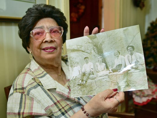 Mildred Kelly holds a photograph of her family, including her dad, Arthur Barbour, second from left.  Kelly is 90 and has seen a lot of changes in racial attitudes. She said she is the oldest African-American who grew up in Chambersburg and still lives in the town.