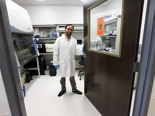 Julio Rincon stands inside the new lab for his startup,
