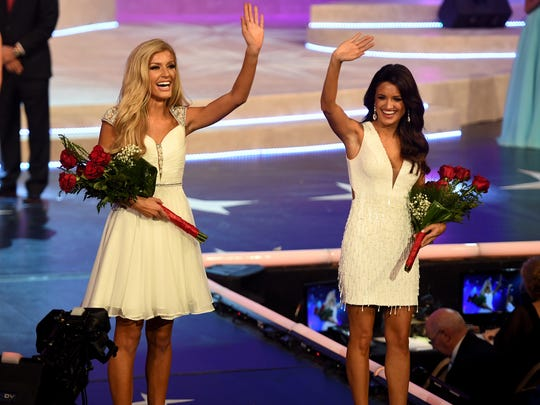 Miss Chattanooga Christine Williamson and Miss Mid South Amber Reed take the runway after being named Talent and Fitness preliminary winners at the Miss Tennessee Scholarship Pageant, Friday, June 22.