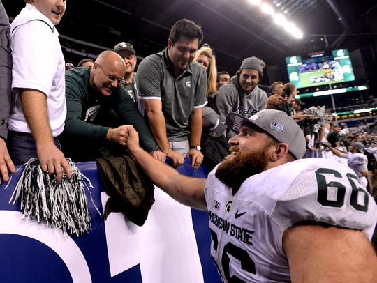 Offensive lineman Jack Allen shakes hands with fans