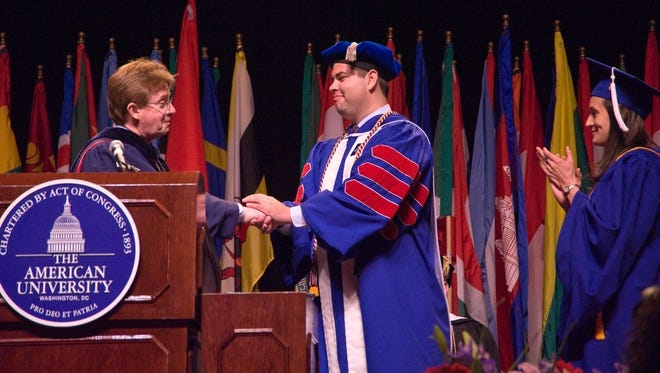 Seth Cutter, of Cold Spring, receives American University's President's Award at graduation.