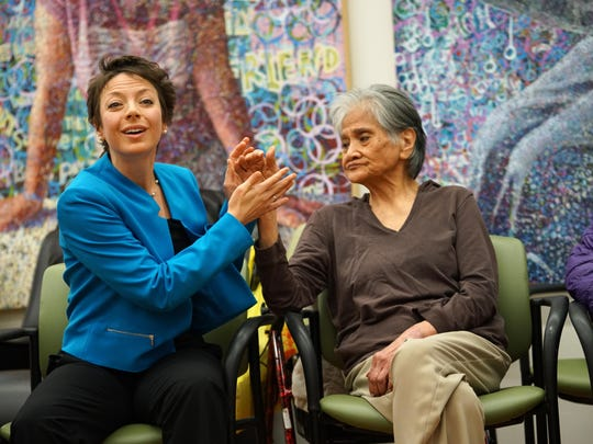 Natasha Goldstein-Levitas, a dance/movement therapist, holds the hand of Gloria Bayle, during her class for aging adults with memory and cognitive impairments at NewCourtland LIFE, an independent healthcare facility in Philadelphia.