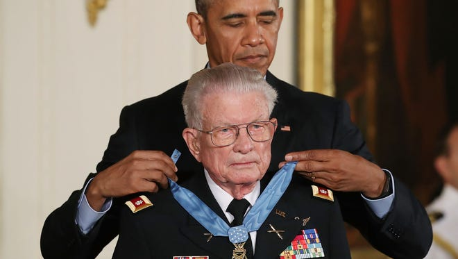 President Obama presents the Medal of Honor to retired Army Lt. Col. Charles Kettles, during a ceremony in the East Room of the White House on July 18, 2016.