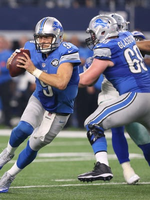 Detroit Lions quarterback Matthew Stafford (9) scrambles in fourth quarter Monday, Dec. 26, 2016 in AT&T Stadium in Arlington, Texas. The Cowboys won, 42-21.