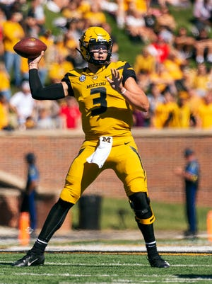 FILE - In this Saturday, Sept. 22, 2018, file photo, Missouri quarterback Drew Lock throws a pass during the first half of an NCAA college football game against Georgia in Columbia, Mo. The bye week came at a good time for Lock and Missouri, which hung with Georgia before mistakes wound up biting them. Missouri committed three turnovers and had a punt blocked that resulted in a touchdown. (AP Photo/L.G. Patterson)