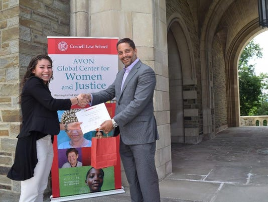 Dean Peñalver presenting Olivia with her first place certificate.