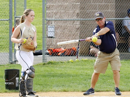 Steve Weber hits infield practice to the Elmira Notre Dame softball team in 2017.