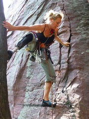 Chris Prange-Morgan goes rock climbing with her prosthetic leg at Devil's Lake State Park in June 2014.