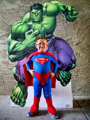 In his Superman costume, Dylan Marshall, 5, poses with