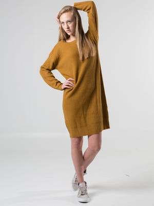 """The perfect slouchy-chic combo: Sweater dress plus unlaced high tops. Onetheland sweater dress, $48, """"Silver Cloud"""" Vans, $75, all at Von Maur, on Katie Kinman for Heyman Talent."""