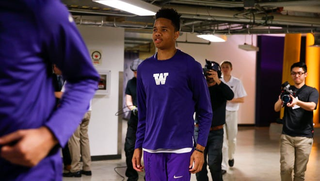 UW guard Markelle Fultz (center) exits the locker room before a game last week against Colorado.