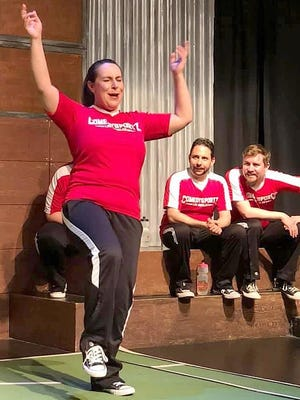 Former Pratt Resident Niki Hart (left) performs an improv act in the El Portal Theatre in Los Angeles with the ComedySportz troupe in the last show before all theaters were closed in L.A. Watching are husband Chad Shapiro (seated left) and Brad West. Hidden behind Hart is Arlie Schrantz.
