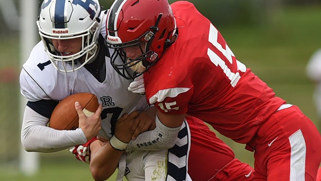 Field's Dallas McAmis and Nolan Snyder tackle Rootstown's Trey Burch in a 2019 contest.