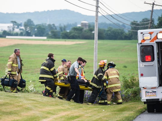 Emergency crews carry the driver to an awaiting ambulance after they were dispatched to the intersection of Royal Road and Rt. 934 in South Annville Township around 7:50 a.m. on Wednesday, June 21, 2017. One person was transported to the Hershey Medical Center, according to an official at the scene.