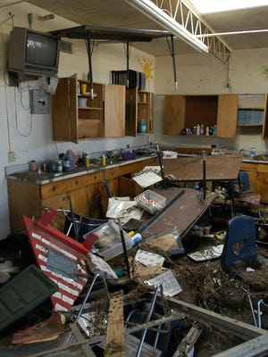 St. Martin's Middle School was flooded to the ceiling. Tables floated on the rising waters and became stuck in the structural supports. The middle and upper elementary schools in Ocean Springs were flooded by the tidal surge of Hurricane Katrina.