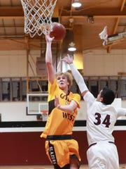 Golden West's Hunter Bayne shoots over the top of Mt