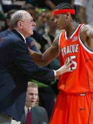 Syracuse coach Jim Boeheim, left, gives instructions