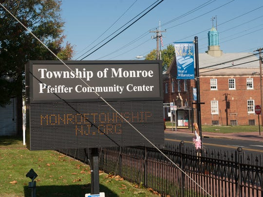 A Monroe Township sign is shown at the Pfeiffer Center (MT Community Center) near a banner sign of Williamstown on main Street. Monroe Township has spent $27,000 to a marketing firm to brand the Williamstown section of town to businesses.