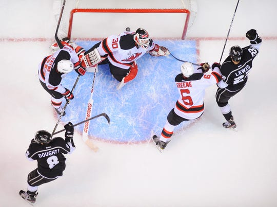 The Devils and Kings during the 2012 Stanley Cup Final. Devils defenseman Andy Greene (6) is one of three New Jersey players remaining on the roster from that series, which was won by the Kings in six games. (AP Photo/Mark Terrill)