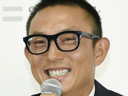 In this April 1, 2017, photo, Munenori Kawasaki, who was dropped from the Chicago Cubs, smiles during a press conference after joining SoftBank Hawks in Fukuoka, southwestern Japan. Former major league infielder Kawasaki is likely to retire after being released by the Japanese professional baseball club on Monday, March 26, 2018. In a statement released by the Hawks, the 36-year-old infielder said a series of injuries has prevented him from being the player he wanted to be. (Kyodo News via AP)