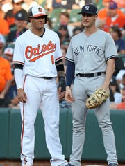 Jul 10, 2018; Baltimore, MD, USA; Baltimore Orioles shortstop Manny Machado (13) talks with New York Yankees first baseman Greg Bird (33) following his first inning single against the New York Yankees at Oriole Park at Camden Yards.