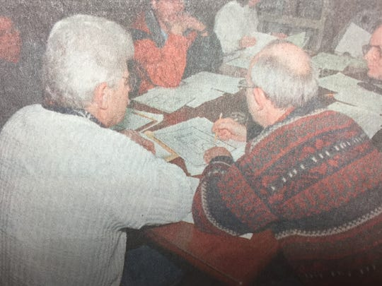 Sturgis city council members Russell Holeman (left) and Tommy Holt looked over the floor plan of  the Alloway Building during a special meeting in February 1999.