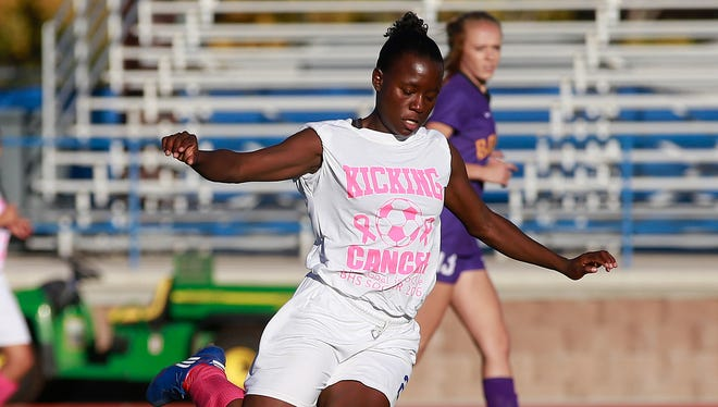 Bloomfield's Vanessa Harris takes a shot against Kirtland Central on Oct. 18 at Bobcat Stadium in Bloomfield.
