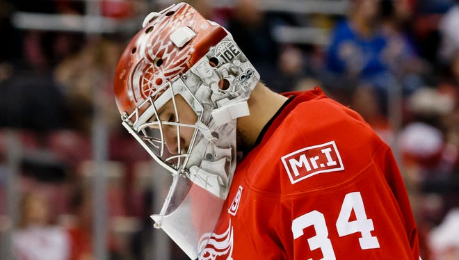 Feb 15, 2017; Detroit, MI, USA; Red Wings goalie Petr Mrazek displays a patch on his sweater for owner Mike Ilitch in the third period against the Blues at Joe Louis Arena. Ilitch passed away Feb. 10, 2017.