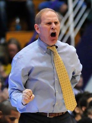 Michigan basketball coach John Beilein shouts instructions Tuesday, March 3, 2015.