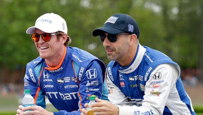 Apr 23, 2017; Birmingham, AL, USA; Indycar series drivers Scott Dixon (9) (left) and Tony Kanaan (10) ride to driver introductions prior to the Honda Indy Grand Prix of Alabama at Barber Motorsports Park.