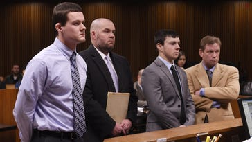 Michael Roth, 17, and his attorney James Sparrow, Tanner Coolsaet, 18, and his attorney Edward Holmberg, listen to Judge David Groner during sentencing at the Frank Murphy Hall of Justice on January 11, 2017.