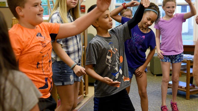 Meadow Montessori School fourth through sixth grade students exercise during Meg Fedorowicz's class in September, 2018. The school is reopening to in-person learning after a months-long closure in response to the COVID-19 pandemic.