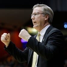 Iowa head coach Fran McCaffery works against Tennessee in the first half of a first-round game of the NCAA college basketball tournament, March 19, 2014, in Dayton, Ohio.