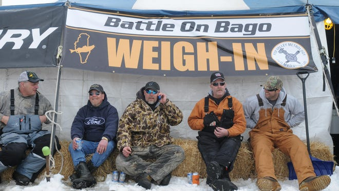 This group of ice fishermen, from left, Kevin Welch, Dennis Loertscher, Jeff Pomplun Rick Stanton and his brother, Ryan, returned to the weigh-in tent early to avoid a long wait in line during the Battle on Bago ice fishing tournament in 2014. This year's event is Feb. 12 through 14.