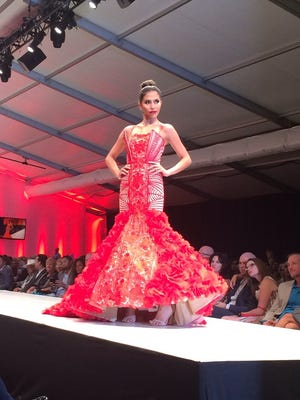 An Oliver Tolentino design walks the runway at the Fashion Week El Paseo 10th Anniversary runway show on Saturday, March 21, 2015.