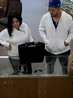 Surveillance photo of the jewelry store credit card fraud suspects.