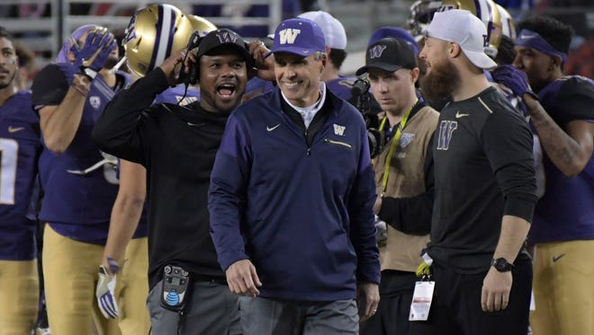 Chris Petersen walks the sideline as the Washington Huskies close in on the Pac-12 title on Dec. 2.