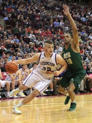 Lexington's Cade Stover was in Columbus, his future home, last month to play in the Final Four with the Minutemen against Akron St. Vincent-St. Mary. Stover was second team All-Ohio in basketball to go with his first team honors in football.