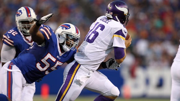 Bills linebacker Jerry Huges (55) pressures Vikings quarterback Matt Cassel.