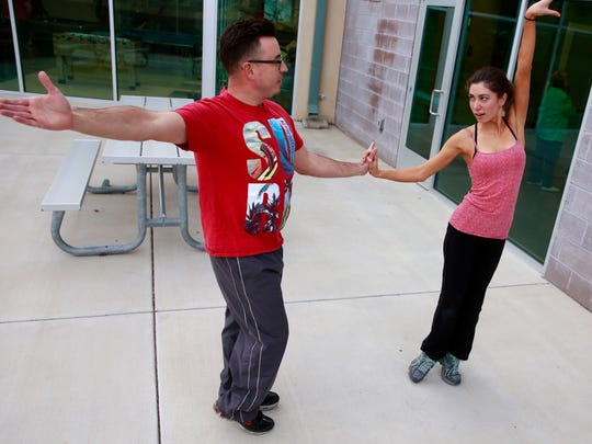 """Utah Ballroom Dance Company instructor Marina Hattan, right, rehearses a paso doble with Keith Neil in preparation for """"Dancing With Farmington's Stars"""" on Thursday at the Sycamore Park Community Center."""