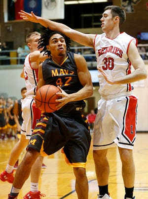 Action as McCutcheon visits Logansport Friday, January 15, 2016, at Logansport High School. McCutcheon defeated Logansport 70-55, the first loss of the season for the Berries.