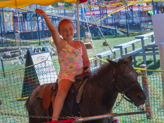 Ava Wyslotsky, 6, of Beachwood enjoys a pony ride at