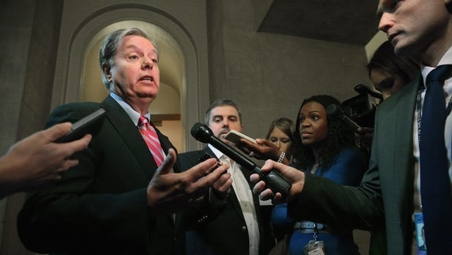 Sen. Lindsey Graham, R-S.C., talks to reporters after leaving a Senate Republican caucus meeting at the Capitol on Oct. 11.