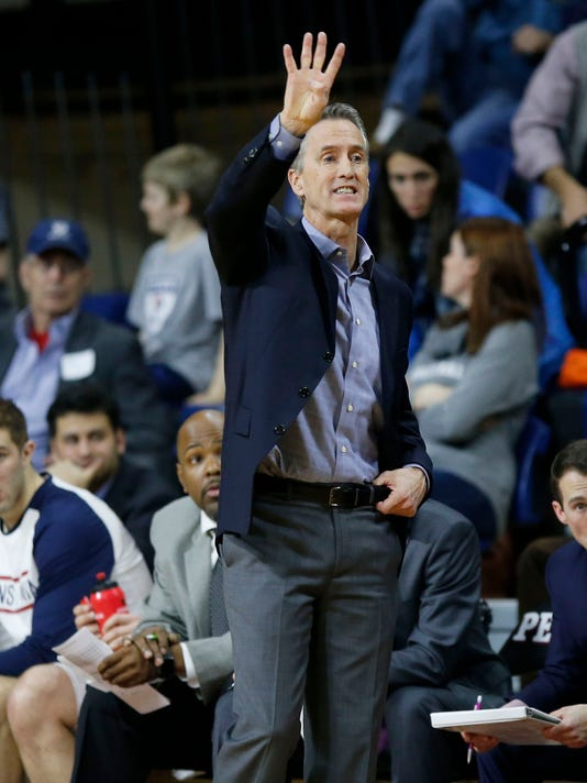 Penn coach Steve Donahue gestures to the team during the first half of an NCAA college basketball game against Columbia on Friday, Feb. 10, 2017, in Philadelphia. (Yong Kim/The Philadelphia Inquirer via AP)