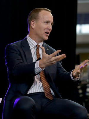 Former Indianapolis Colts quarterback Peyton Manning answers questions from Marian University's Will Hampton after he was honored with the Marian University Clayton Circle of Honor Tuesday evening at Lucas Oil Stadium.