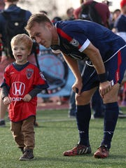 Indy Eleven midfielder Brad Ring (4) and his son Lincoln.